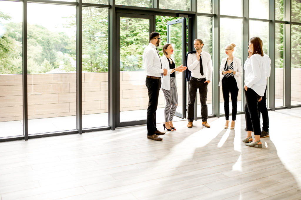 Team of property managers collaborating inside an upscale home